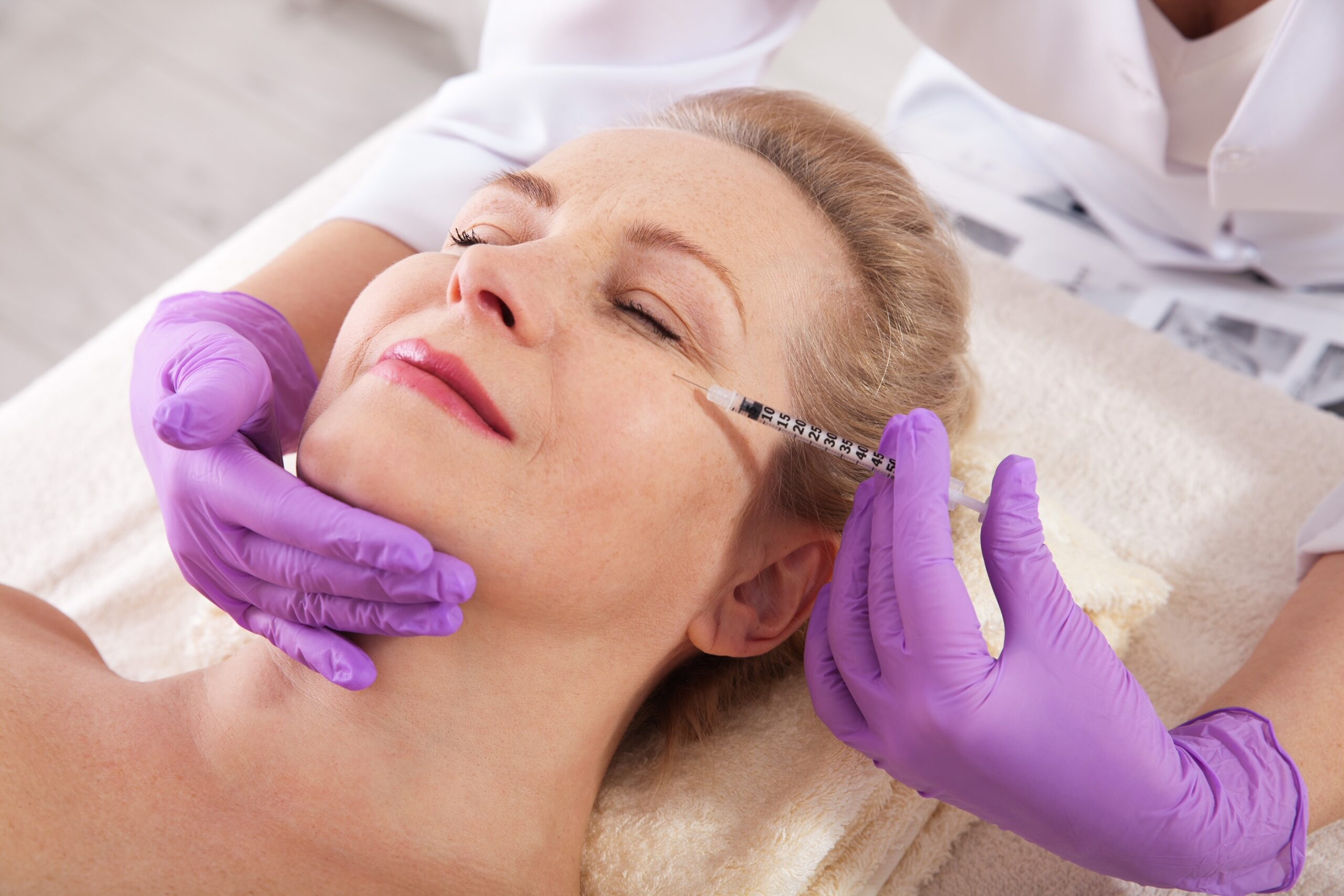 Botox injection on female face